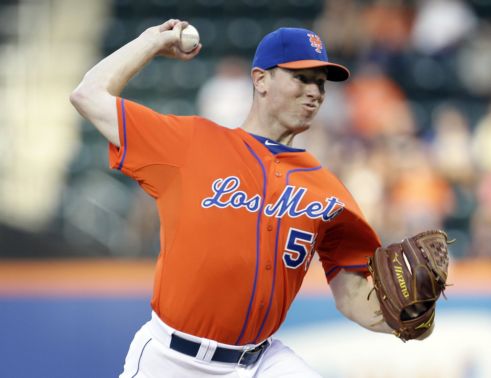 Photo - New York Mets' Jeremy Hefner delivers a pitch during the first inning of a baseball game against the Atlanta Braves, Wednesday, July 24, 2013, in New York. (AP Photo/Frank Franklin II)