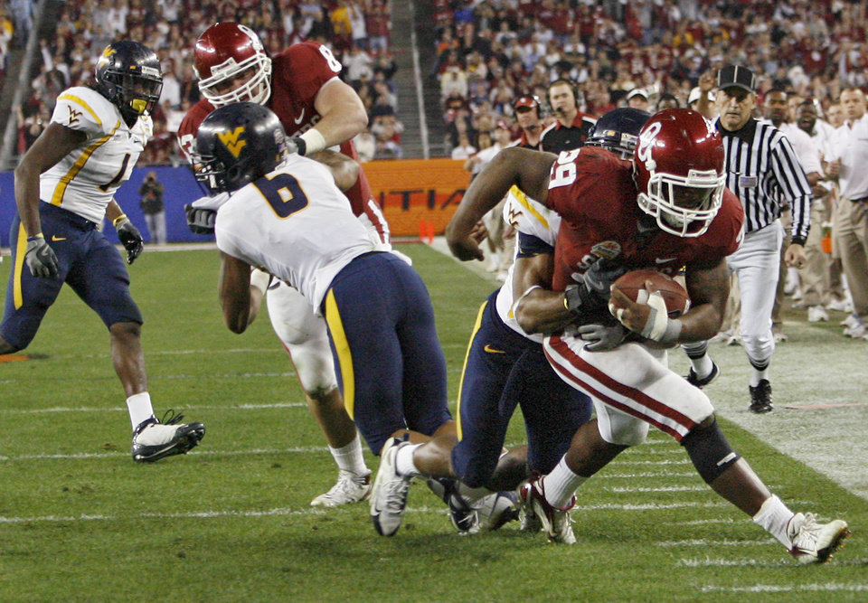 Photo - Oklahoma's Chris Brown (29) fights his way to the end zone during the second half of the Fiesta Bowl college football game between the University of Oklahoma Sooners (OU) and the West Virginia University Mountaineers (WVU) at The University of Phoenix Stadium on Wednesday, Jan. 2, 2008, in Glendale, Ariz. 