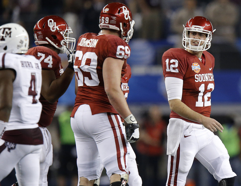 Photo - Oklahoma's Landry Jones (12) reacts after a play in the Cotton Bowl college football game between the University of Oklahoma (OU)and Texas A&M University at Cowboys Stadium in Arlington, Texas, Friday, Jan. 4, 2013. Oklahoma lost 41-13. Photo by Bryan Terry, The Oklahoman