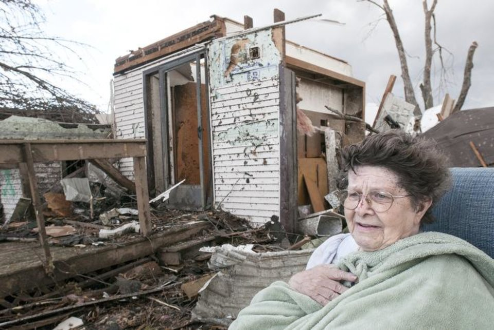 Photo - Pat Whitaker, 82, sits under a blanket in her nightgown outside her home waiting for help to come in Gifford, Ill. on Sunday, Nov. 17, 2013. Intense thunderstorms and tornadoes swept across the Midwest, causing extensive damage in several central Illinois communities while sending people to their basements for shelter. (AP Photo/The News-Gazette, Robin Scholz)