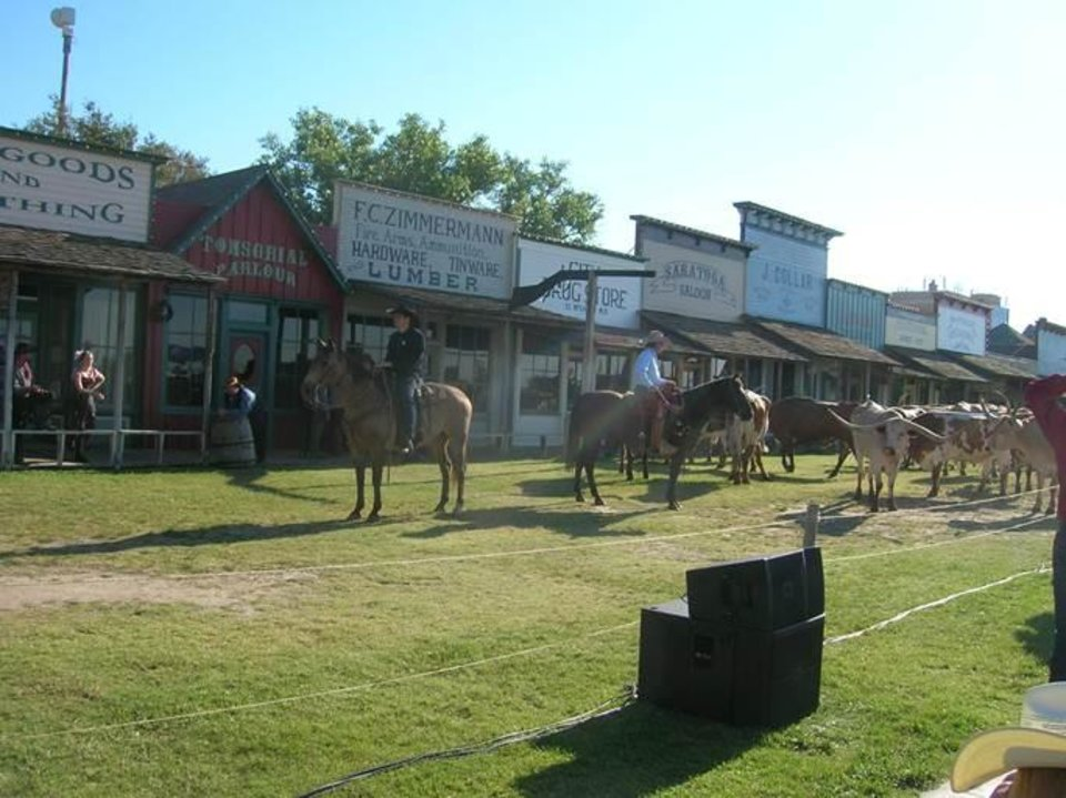 "Photo -  The historical Boot Hill Museum section of Dodge City, Kan., was the start of a cattle drive during Dodge Days. The cattle drive, the first major one since the 1880s, featured 59 longhorns, marking the 59th anniversary of the start of the ""Gunsmoke"" television western. Photo by Steve Gust, for The Oklahoman"