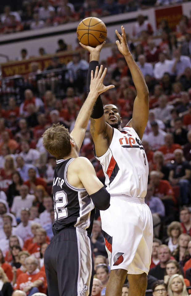 Photo - Portland Trail Blazers' LaMarcus Aldridge, right, shoots as San Antonio Spurs' Tiago Splitter (22) defends in the first quarter during Game 4 of a Western Conference semifinal NBA basketball playoff series Monday, May 12, 2014, in Portland, Ore. (AP Photo/Rick Bowmer)