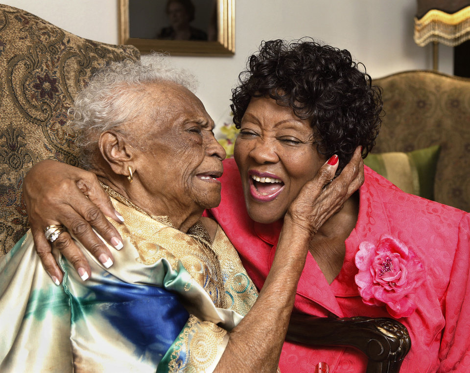 Photo - Ruth Benford, 78, right, recently received her degree from the University of Phoenix.  She spends some of her time with her good friend, 96 year-old Ethel Wilcox.  Jim Beckel - THE OKLAHOMAN