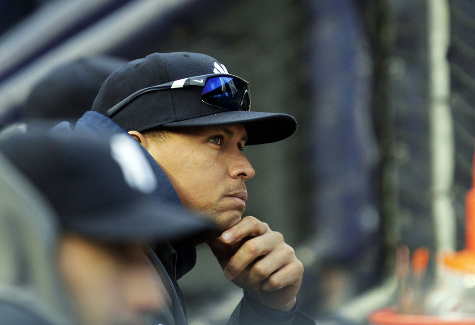 New York Yankees' Alex Rodriguez watches from the dugout during the first inning of Game 5 of the American League division baseball series against the Baltimore Orioles, Friday, Oct. 12, 2012, in New York. (AP Photo/Kathy Willens)