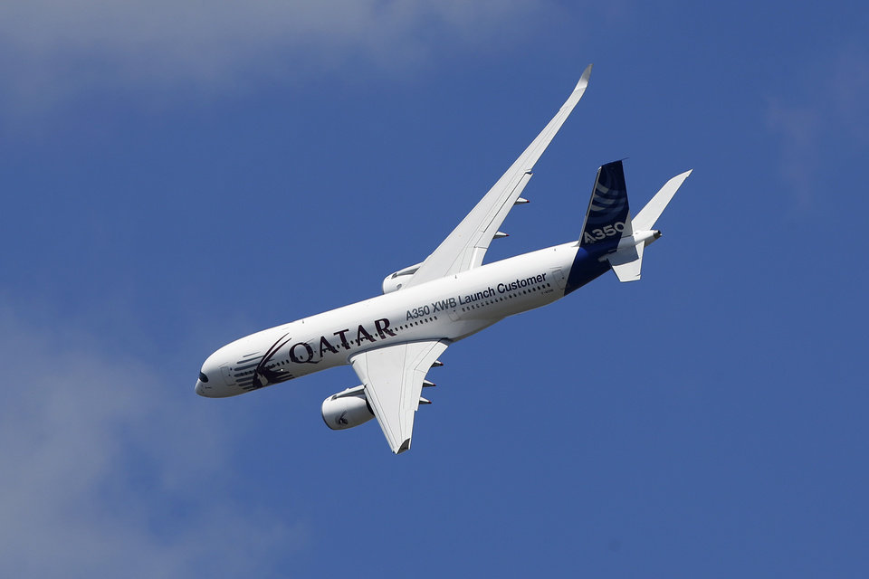 Photo - An Airbus A350 XWB flies on display during Farnborough International Air Show, Farnborough, England, Monday, July 14, 2014. (AP Photo/Sang Tan)