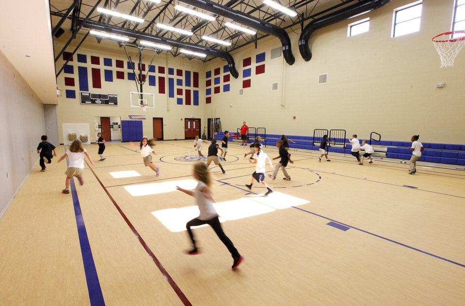 Photo -  Students exercise in the gym at Arbor Grove Elementary School. Photo by Paul B. Southerland, The Oklahoman   PAUL B. SOUTHERLAND -