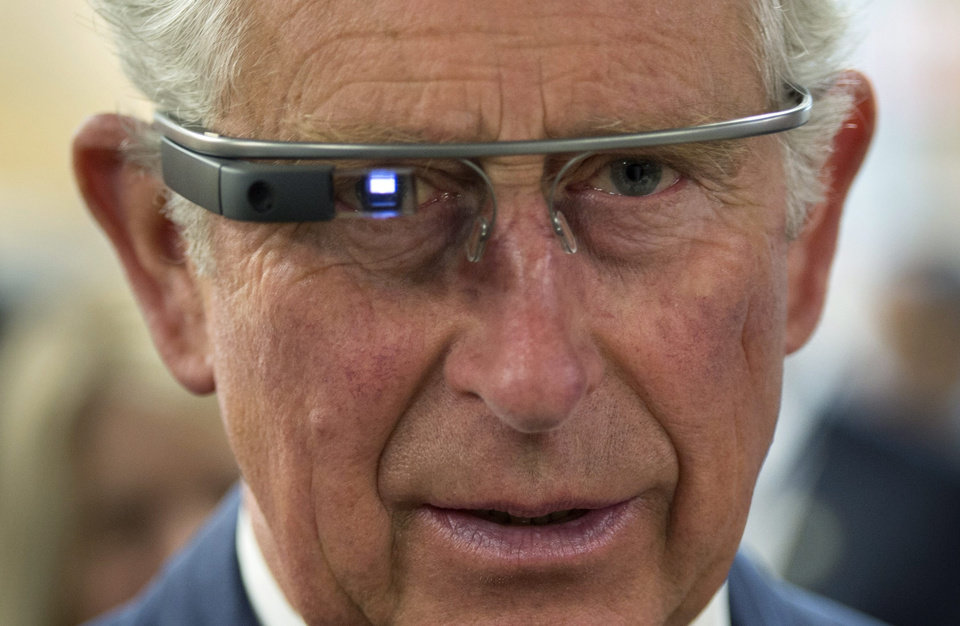 Photo - Prince Charles tries on Google Glass in Winnipeg on Wednesday, May 21, 2014.  Wednesday, May 21, 2014. The Royal couple are on a four-day tour of Canada. (AP Photo/The Canadian Press, Paul Chiasson)