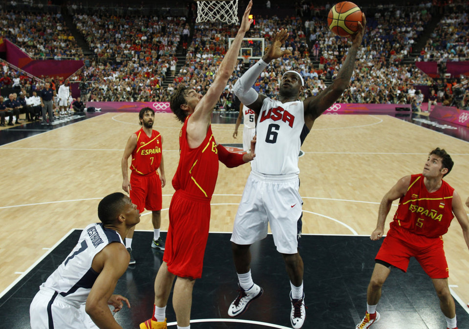 The United State's Lebron James,center, shoots over Spain's Pau Gasol during their men's gold medal basketball match at the North Greenwich Arena in London during the London 2012 Olympic Games, Sunday, Aug. 12, 2012.( AP Photo/ Sergio Perez, Pool)