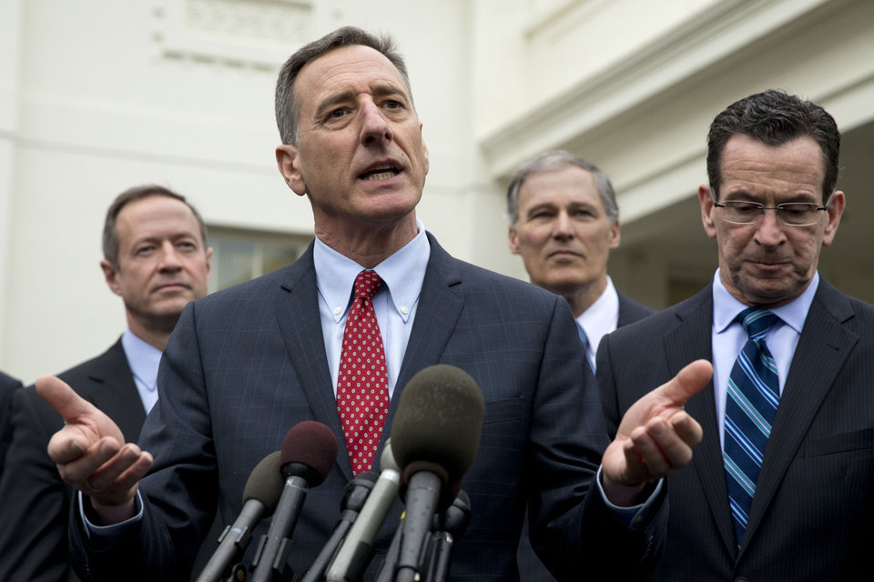 Photo - Democratic Governors Association Chairman, Vermont Gov. Peter Shumlin, second from left, speaks to the media outside the White House in Washington, Friday, Feb. 21, 2014, following a meeting  President Barack Obama and Vice President Joe Biden. From left are, Maryland Gov. Martin O'Malley, Shumlin, Washington Gov. Jay Inslee, and Connecticut Gov. Dan Malloy.  (AP Photo/Jacquelyn Martin)