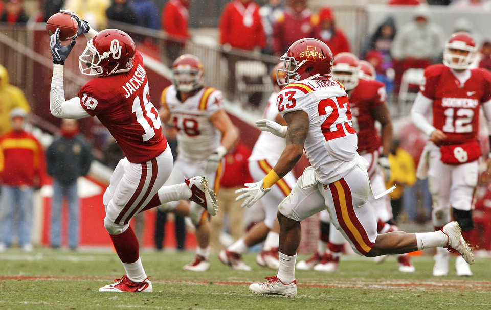 Oklahoma's Kameel Jackson (18) catches a pass in front of Leonard Johnson (23) during the second half of a college football game in which  the University of Oklahoma Sooners (OU) defeated the Iowa State University Cyclones (ISU) 26-6 at Gaylord Family-Oklahoma Memorial Stadium in Norman, Okla., Saturday, Nov. 26, 2011. Photo by Steve Sinsey, The Oklahoman