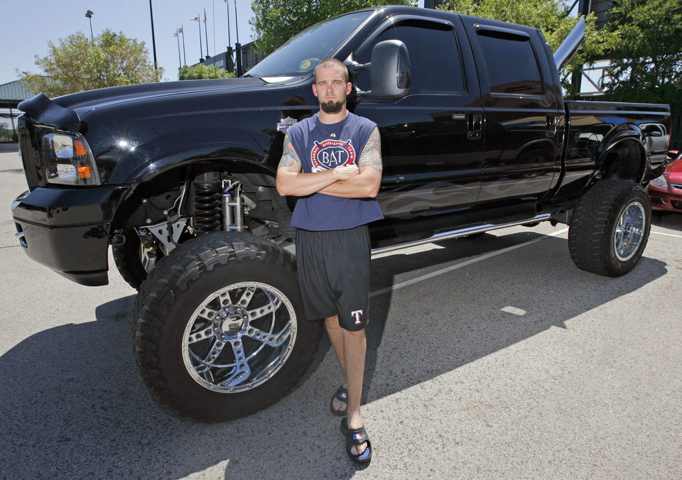 Photo - MINOR LEAGUE BASEBALL: Oklahoma City RedHawks' Josh Rupe poses for a photo with his truck at the AT&T Bricktown Ballpark in Oklahoma City, Friday, July 10, 2009. Rupe was voted as having the best vehicle by his RedHawks teammates. Photo by Nate Billings, The Oklahoman  ORG XMIT: KOD