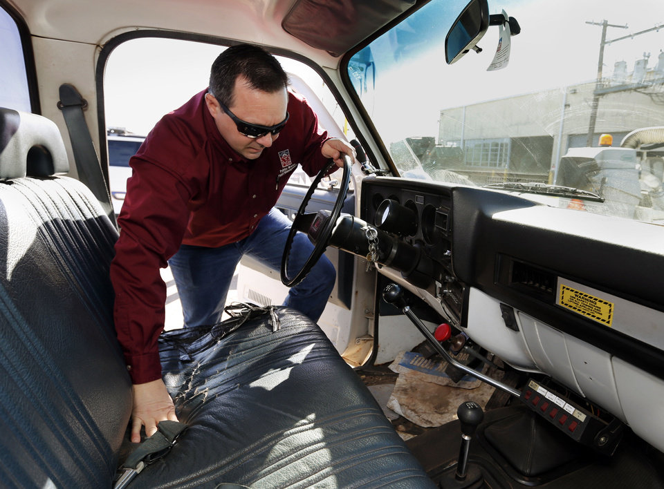 Mike White, Norman's fleet manager, climbs into the cab of a 1988 Chevrolet wrecker, just one of the 550-plus vehicles the city owns and operates.
