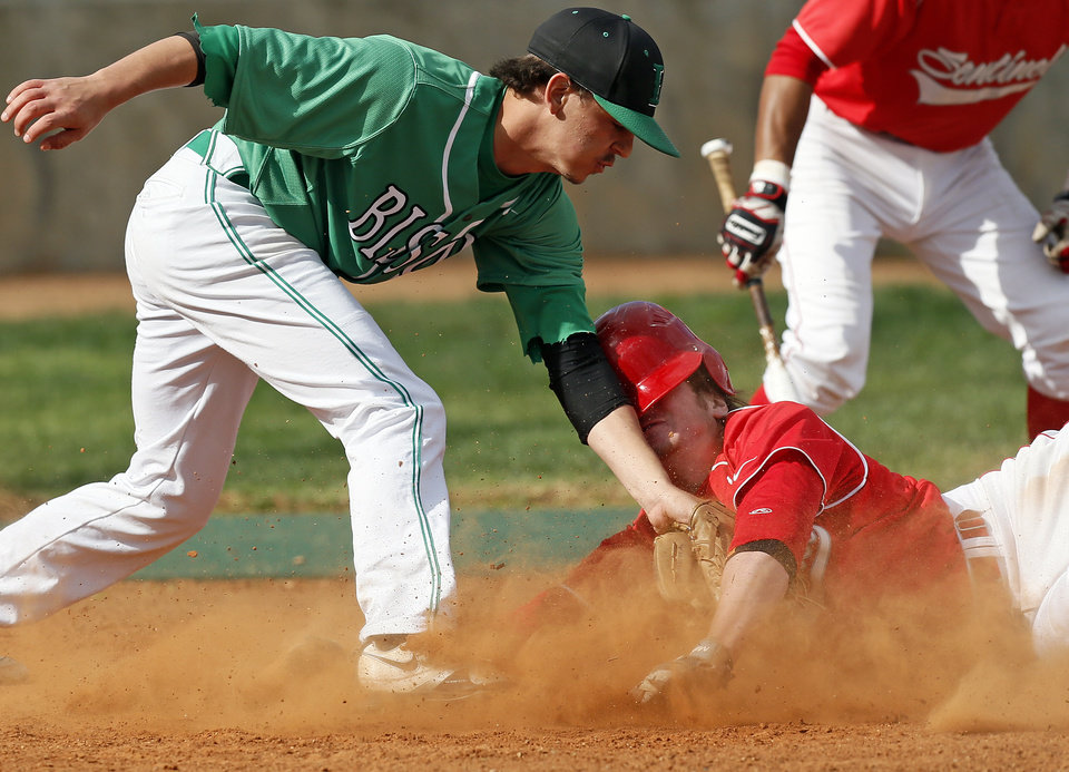 Photo - Sentinel's Weston Cole (9) slides home to score as Leedey's Chase Beverly (8) tries to make the tag in the first inning during a Class B high school baseball game between between Leedey and Sentinel in the state baseball tournament at the Edmond Memorial baseball field in Edmond, Okla., Friday, May 3, 2013. Photo by Nate Billings, The Oklahoman