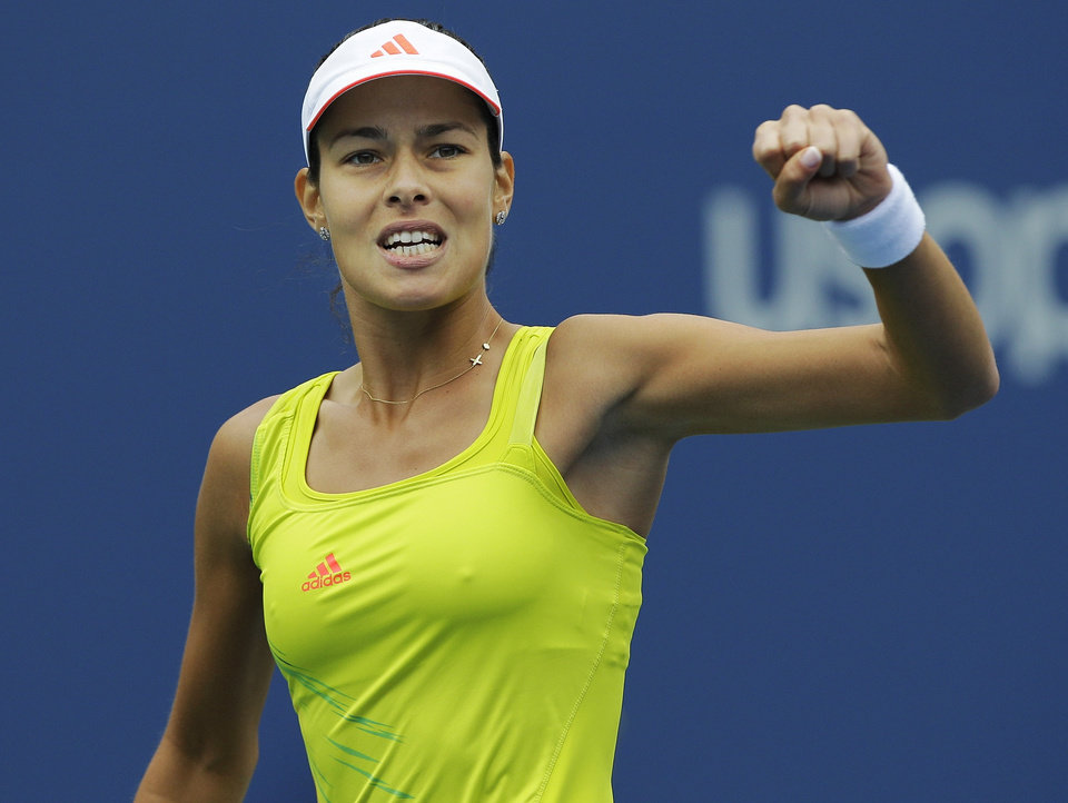Photo -   Serbia's Ana Ivanovic reacts during her match against Bulgaria's Tsvetana Pironkova in the fourth round of play at the 2012 US Open tennis tournament, Monday, Sept. 3, 2012, in New York. (AP Photo/Kathy Willens)