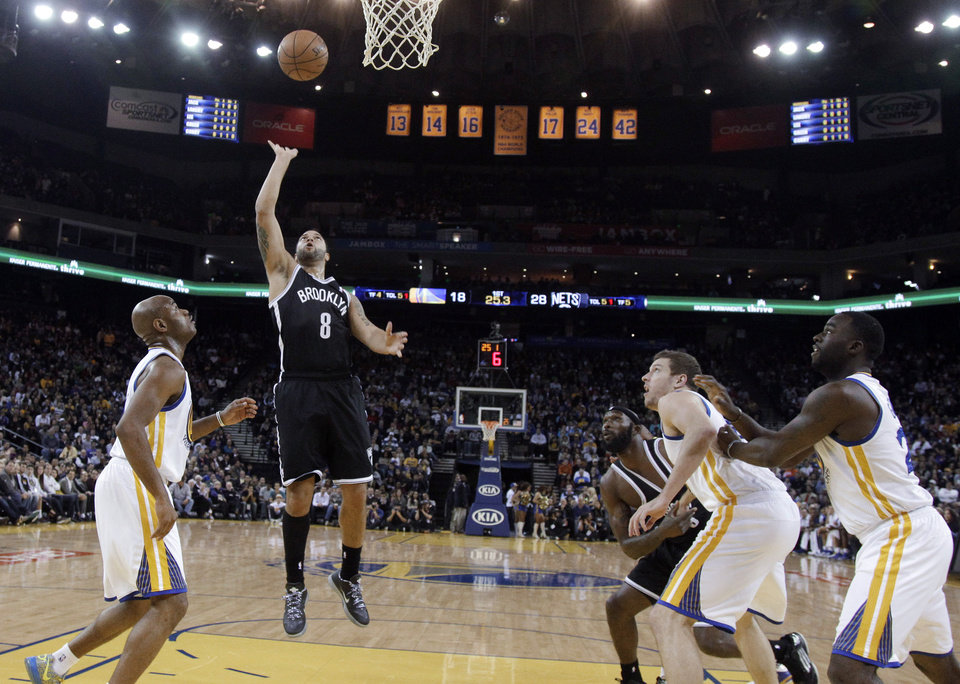 Photo -   Brooklyn Nets' Deron Williams (8) scores against the Golden State Warriors during the first half of an NBA basketball game in Oakland, Calif., Wednesday, Nov. 21, 2012. (AP Photo/Marcio Jose Sanchez)