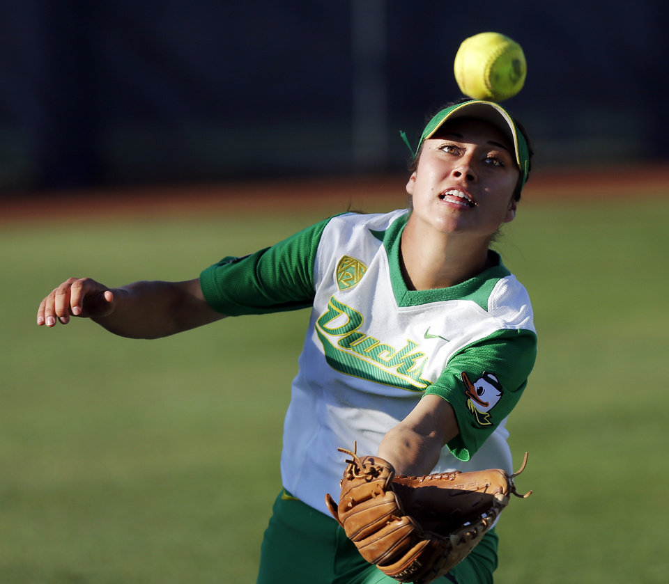 Photo - Oregon's Janie Takeda (19) catches a fly ball in the 3rd inning during Game 5 of the Women's College World Series softball tournament between Florida and Oregon at ASA Hall of Fame Stadium in Oklahoma City, Friday, May 30, 2014. Photo by Nate Billings, The Oklahoman