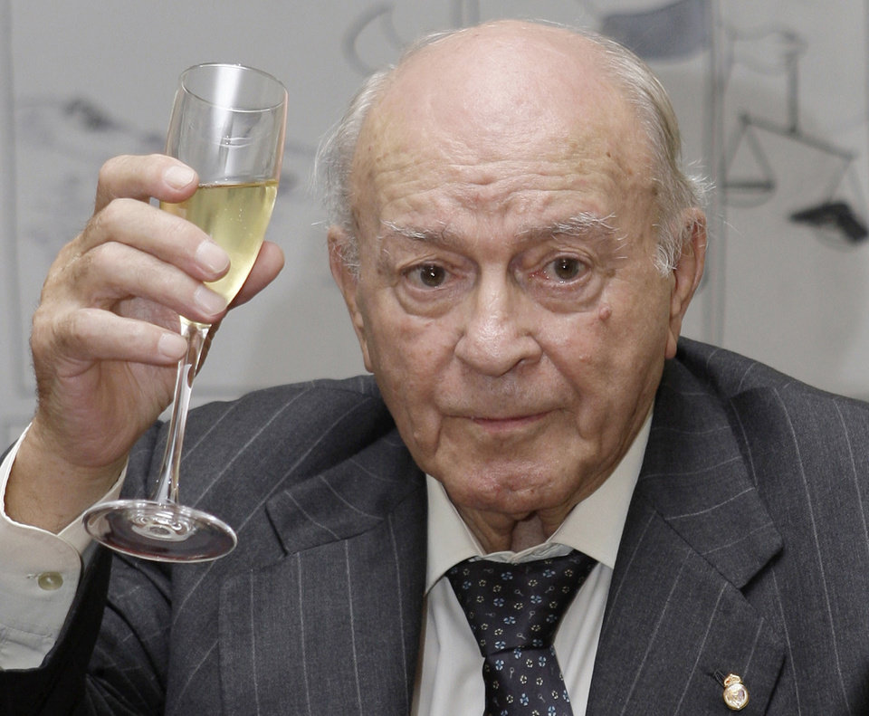 Photo - FILE - In this Nov. 13, 2009 file photo, former Real Madrid soccer star and the club's honorary president, Alfredo Di Stefano of Argentina raises his glass during a tribute to his contribution to sport at the Argentine Embassy in Madrid, Spain. Real Madrid on Monday July 7, 2014 says Alfredo Di Stefano has died at age 88. Di Stefano helped Madrid win five straight European Champions Cups, and was voted European player of the year in 1957 and '59. (AP Photo/Paul White, File)