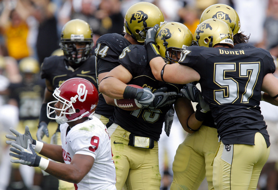 Photo - Colorado's Jordon Dizon (44), Ryan Walters (15), Jake Duren (57) and others celebrate an interception of a pass intended for Oklahoma's Juaquin Iglesias (9) during the second half of the college football game between the University of Oklahoma Sooners (OU) and the University of Colorado Buffaloes (CU) at Folsom Field in Boulder, Co., on Saturday, Sept. 28, 2007. Colorado won, 27-24. By NATE BILLINGS, The Oklahoman