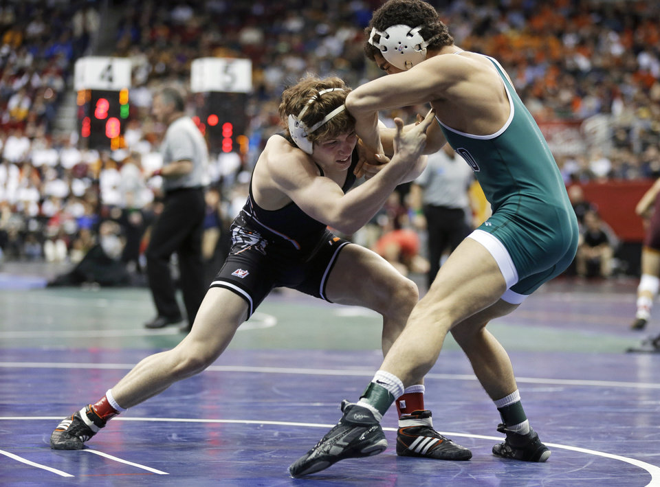Oklahoma State's Alex Dieringer, left, wrestles with Ohio's Spartak Chino during their 157-pound match at the NCAA Division I wrestling championships, Thursday, March 21, 2013, in Des Moines, Iowa. (AP Photo/Charlie Neibergall) ORG XMIT: IACN128