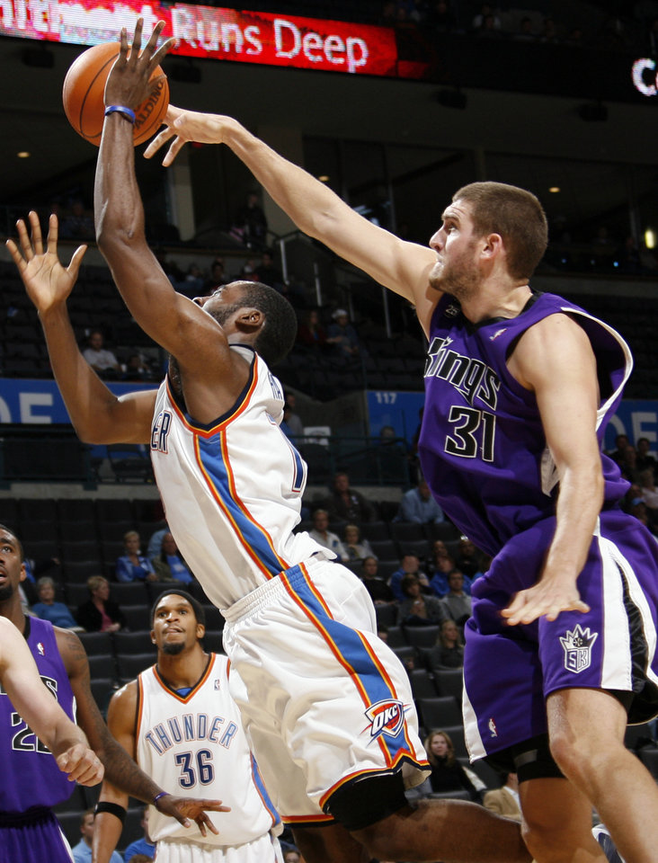Sacramento's Spencer Hawes (31) knocks the ball away from Oklahoma City's James Harden (13) as Etan Thomas (36) looks on during the NBA preseason game between the Sacramento Kings and the Oklahoma City Thunder at the Ford Center in Oklahoma City, Thursday, Oct. 22, 2009. Sacramento won, 104-89. Photo by Nate Billings, The Oklahoman