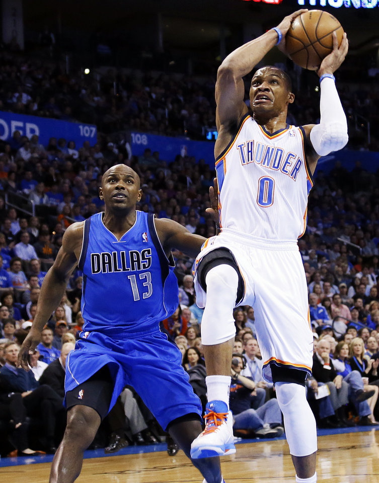 Oklahoma City's Russell Westbrook (0) moves to the hoop in front of Dallas' Mike James (13) during an NBA basketball game between the Oklahoma City Thunder and the Dallas Mavericks at Chesapeake Energy Arena in Oklahoma City, Monday, Feb. 4, 2013. Photo by Nate Billings, The Oklahoman