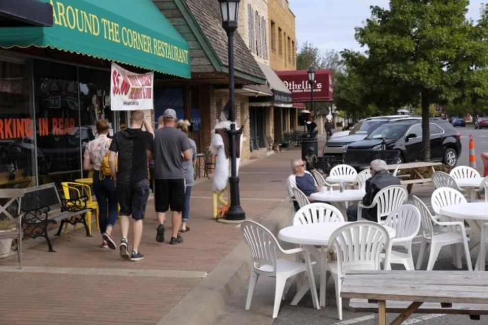 Photo - Round the Corner Restaurant. Streateries in downtown Edmond. Restaurants/cafes were allowed  to take over street space to expand their dining options during the pandemic. Thursday, October 15, 2020. [Doug Hoke/The Oklahoman]