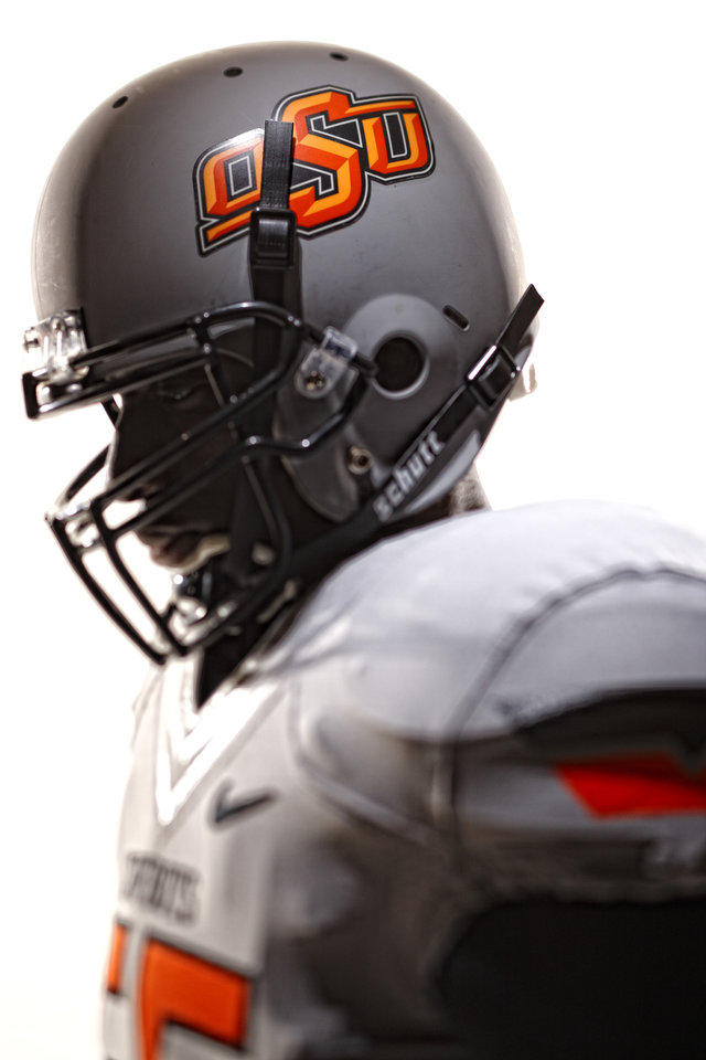 Oklahoma State\'s new football uniforms. Pictured here are the white jersey and the silver helmet. PHOTO PROVIDED