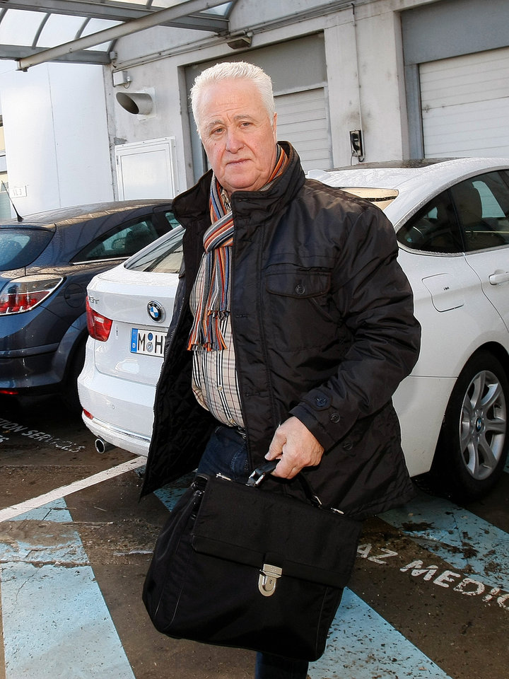 Photo - Michael Schumacher's father Rolf arrives at Grenoble Hospital, French Alps, Sunday Jan. 5, 2014, where former seven-time Formula One champion Michael Schumacher is being treated after sustaining a head injury during a ski accident. Schumacher has been in a medically induced coma since Sunday, Dec. 29, 2013, when he struck his head on a rock while on a family vacation. (AP Photo/Claude Paris)