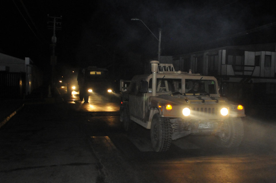 Photo - A military vehicle patrols after an earthquake in Iquique, Chile, Tuesday, April 1, 2014. A powerful magnitude-8.2 earthquake struck off Chile's northern coast Tuesday night. A powerful magnitude-8.2 earthquake struck off northern Chile on Tuesday night, setting off a small tsunami that forced evacuations along the country's entire Pacific coast. (AP Photo/Cristian Viveros) NO PUBLICAR EN CHILE