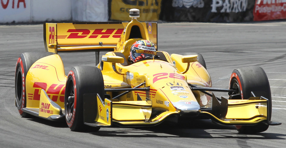 Photo - Ryan Hunter-Reay (28) drives through turns to win the pole position during qualifying for the IndyCar Grand Prix of Long Beach auto race on Saturday, April 12, 2014, in Long Beach, Calif. (AP Photo/Alex Gallardo)