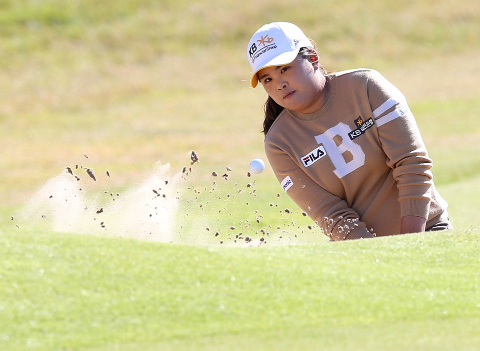 Photo - South Korea's Inbee Park plays her shot from the bunker at the 18th green during the Final day of the Women's British Open golf championship at the Royal Birkdale Golf Club, in Southport, England, Sunday, July 13, 2014. (AP Photo/Scott Heppell)