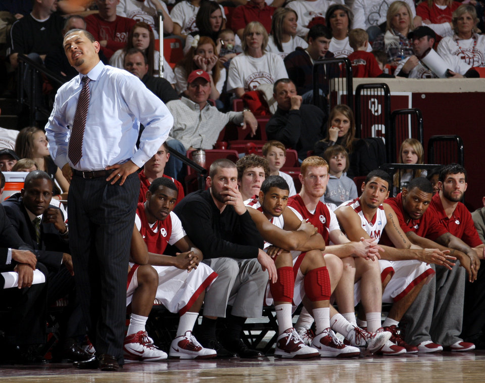 OU coach Jeff Capel and the OU bench watch during the NCAA college basketball game between the University of Oklahoma Sooners and Texas Longhorns at Lloyd Noble Center in Norman, Okla., Wednesday, Feb. 9, 2011. Photo by Bryan Terry, The Oklahoman