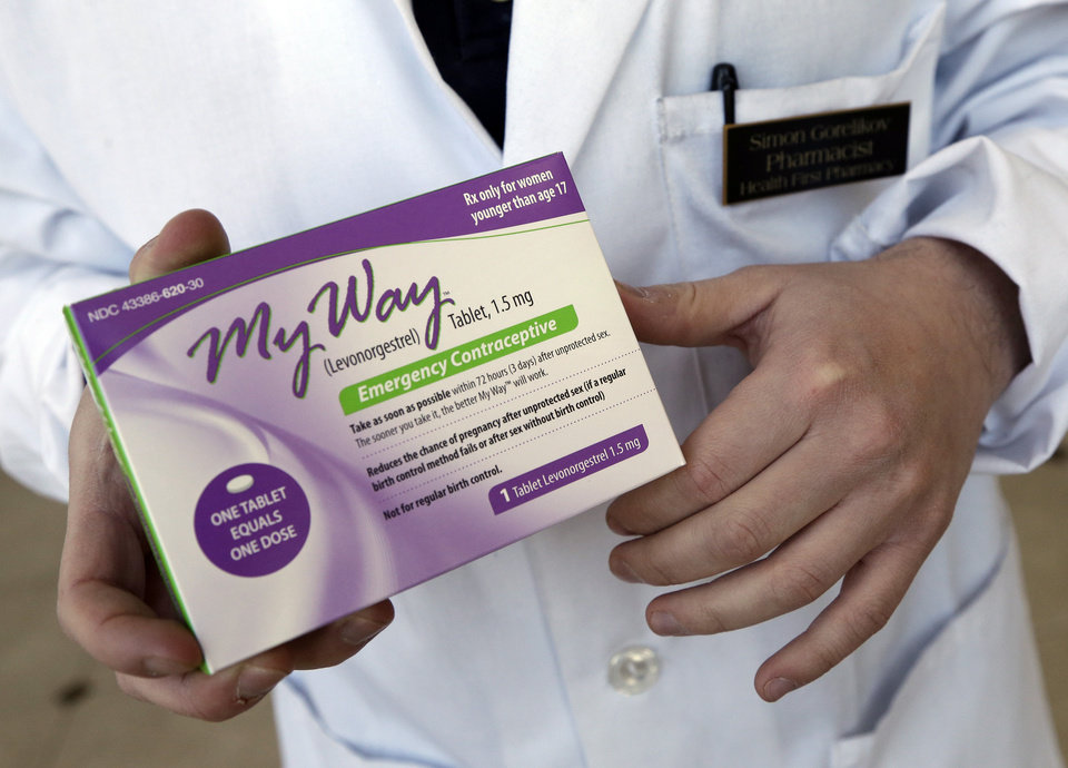 In this May 2, 2013 photo, pharmacist Simon Gorelikov holds a generic emergency contraceptive, also called the morning-after pill, at the Health First Pharmacy in Boston. (AP Photo/Elise Amendola, File)