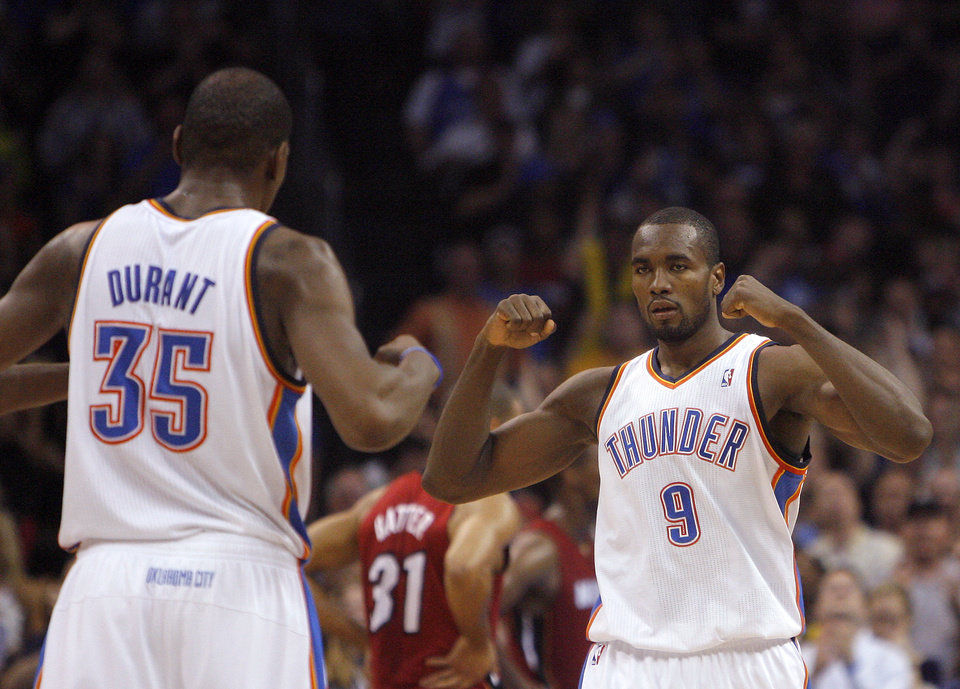 Photo - CELEBRATION: Oklahoma City Thunder's Kevin Durant (35) celebrates with Oklahoma City Thunder's Serge Ibaka (9) during the NBA basketball game between the Miami Heat and the Oklahoma City Thunder at Chesapeake Energy Arena in Oklahoma City, Sunday, March 25, 2012. Photo by Sarah Phipps The Oklahoman
