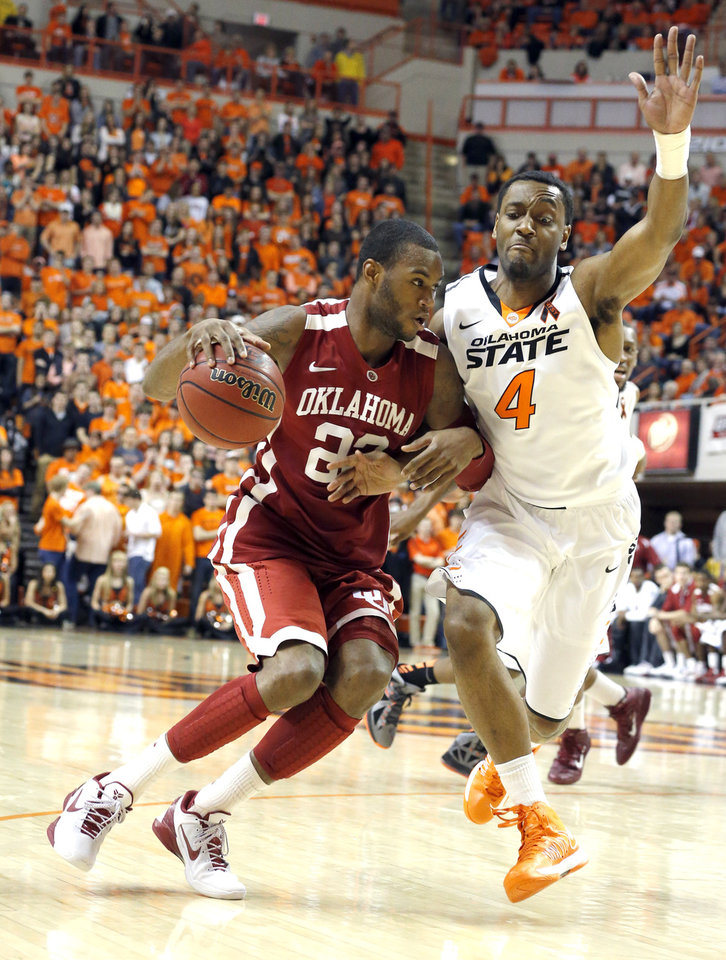 Photo - Oklahoma's Amath M'Baye (22) tries to get by Oklahoma State's Brian Williams (4) during the Bedlam men's college basketball game between the Oklahoma State University Cowboys and the University of Oklahoma Sooners at Gallagher-Iba Arena in Stillwater, Okla., Saturday, Feb. 16, 2013. Photo by Sarah Phipps, The Oklahoman