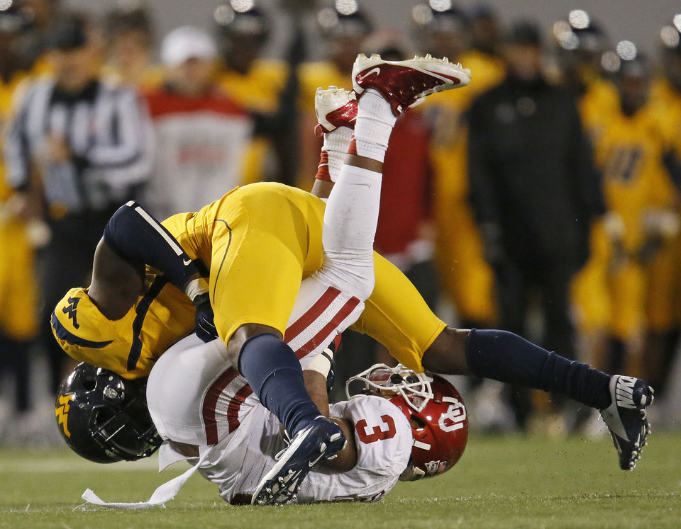 Photo - West Virginia's Karl Joseph (8) stops Oklahoma's Sterling Shepard (3) after  catch during a college football game between the University of Oklahoma and West Virginia University on Mountaineer Field at Milan Puskar Stadium in Morgantown, W. Va., Nov. 17, 2012. OU won, 50-49. Photo by Nate Billings, The Oklahoman
