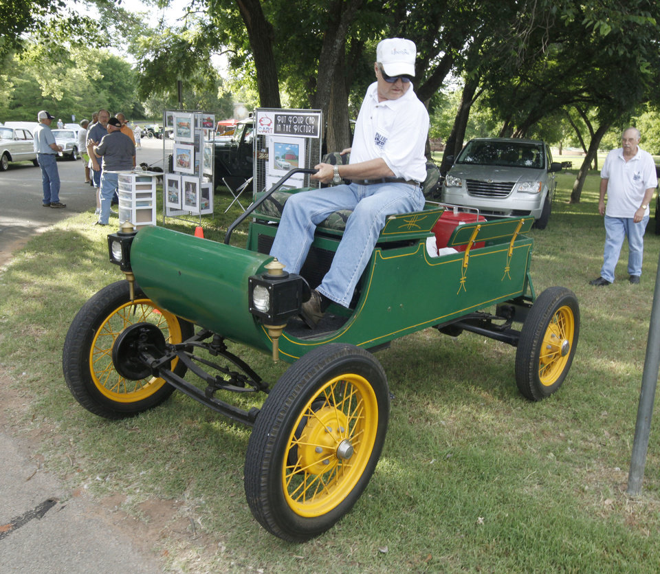 Jerry James parks his shop-built 1901 Oldsmobile replica during the 11th annual car show, part of the LibertyFest celebration at Hafer Park in Edmond, OK, Saturday, June 29, 2013,  Photo by Paul Hellstern, The Oklahoman