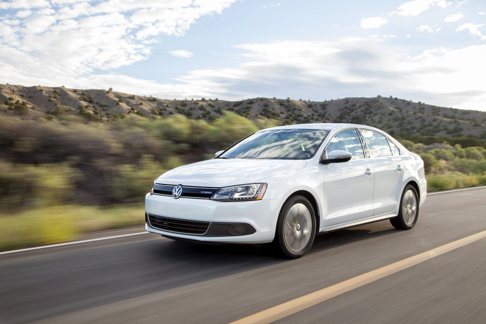 Photo - This photo provided by Volkswagen shows the 2013 Jetta Hybrid. The newest Jetta has the highest mileage rating ever _ a combined 45 miles per gallon in city and highway travel. (AP Photo/Volkswagen)