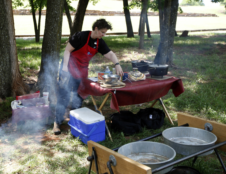 Photo - Kyle Roubidoux cooks at the National Cowboy & Western Heritage Museum in Oklahoma City.  SARAH PHIPPS - THE OKLAHOMAN