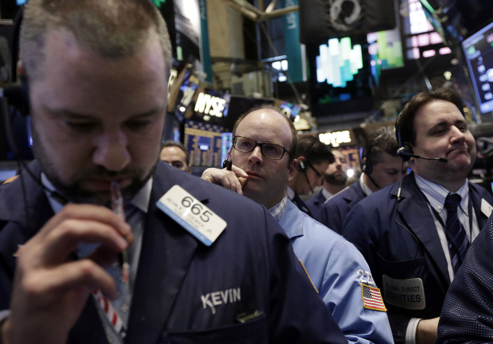 Photo - Traders work on the floor of the New York Stock Exchange, Friday, April 11, 2014. Weaker earnings at JPMorgan Chase are dragging bank stocks lower in early trading. Technology and biotech stocks also fell, a day after the worst rout for the Nasdaq composite index since 2011. (AP Photo/Richard Drew)