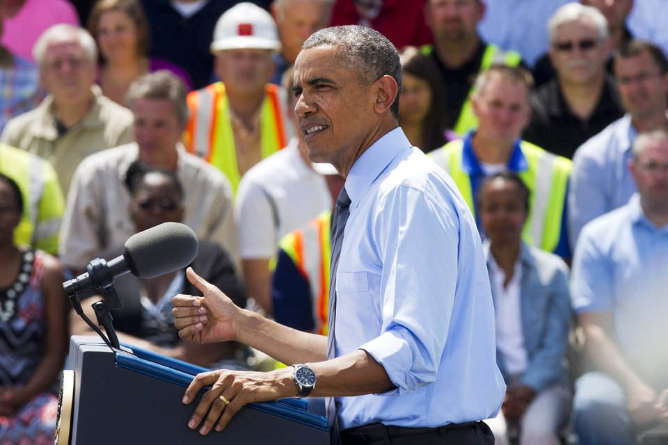 Photo - President Barack Obama speaks about transportation and an initiative to increase private sector investment in national infrastructure, Thursday, July 17, 204, at the Port of Wilmington in Wilmington, Del. near the Interstate 495 Bridge. The federal government is helping pay for repairs to the bridge, which state officials ordered closed on an emergency basis last month because several supporting columns were tilting. (AP Photo/Jacquelyn Martin)