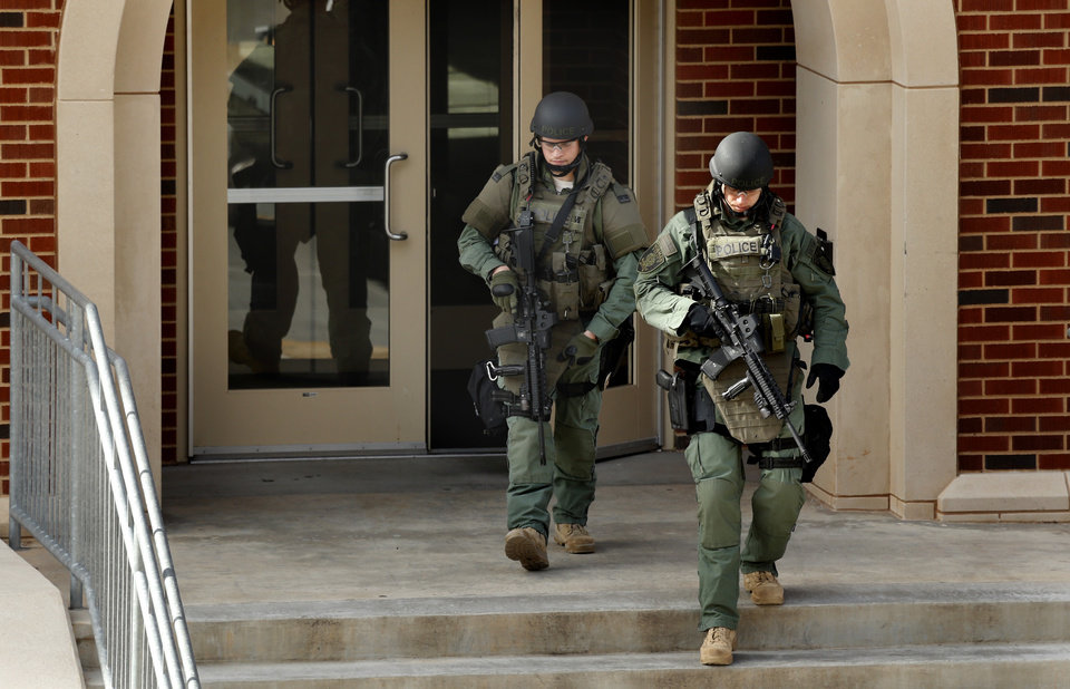 Police leave Gould Hall where a reported shooting proved to be a false alarm on the campus of the University of Oklahoma on Wednesday, Jan. 22, 2014 in Norman, Okla. Photo by Steve Sisney, The Oklahoman