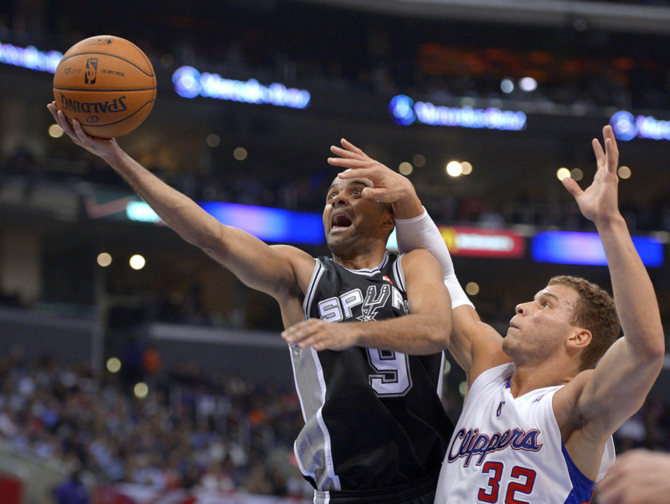 San Antonio Spurs guard Tony Parker, left, of France, goes up for a shot as Los Angeles Clippers forward Blake Griffin defends during the first half of an NBA basketball game, Thursday, Feb. 21, 2013, in Los Angeles. (AP Photo/Mark J. Terrill)