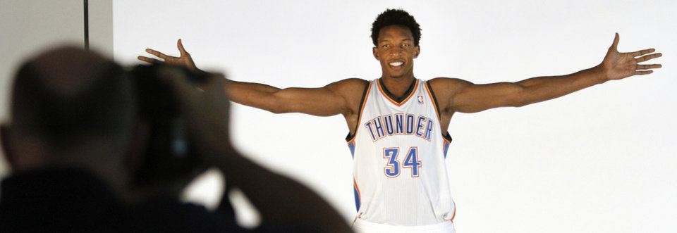 Photo - Hasheem Thabeet poses for photos during media day with the Oklahoma City Thunder in Oklahoma City, Thursday September  27, 2013. Photo By Steve Gooch, The Oklahoman