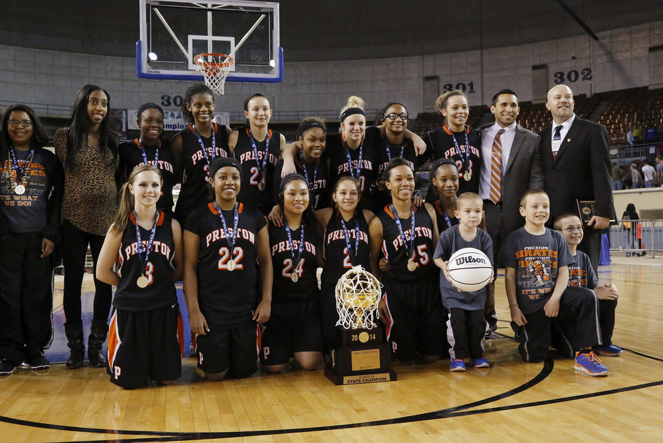 Photo - Preston players and coaches pose for their championship team photo after the Class 2A Girls State Championship game between Preston and Cordell at Jim Norick Arena at State Fair Park  on Saturday, Mar. 15, 2014.  Preston won,  45-41. Photo by Jim Beckel, The Oklahoman