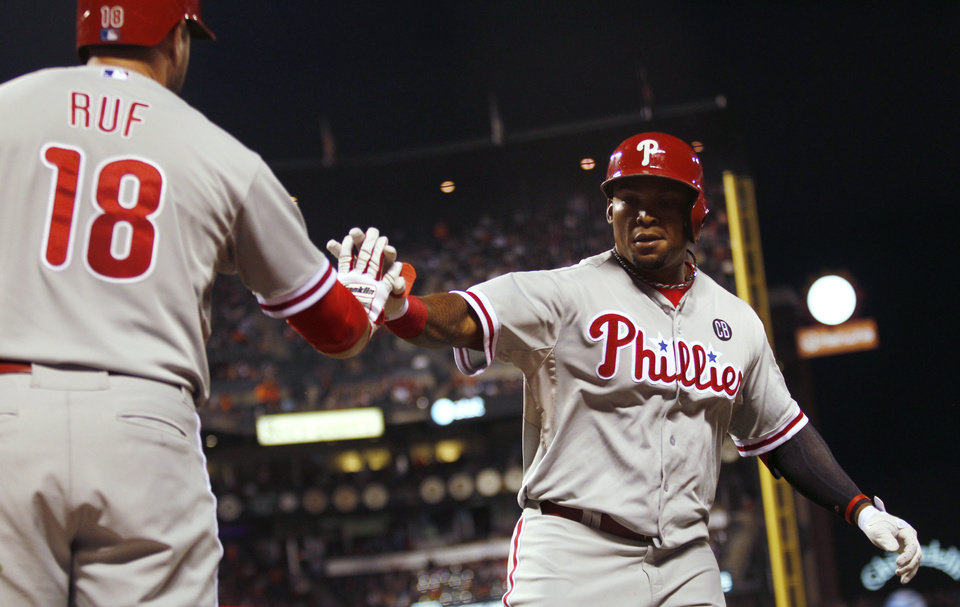 Photo - Philadelphia Phillies' Marlon Byrd, right, is congratulated by Darian Ruf after Byrd hit a home run during the fifth inning of a baseball game against the San Francisco Giants, Friday, Aug. 15, 2014, in San Francisco. (AP Photo/Beck Diefenbach)