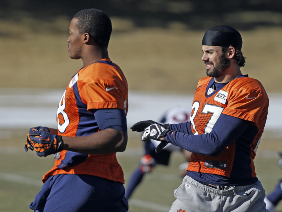 Denver Broncos wide receivers Demaryius Thomas and Eric Decker stretch at football practice at the team\'s training facility in Englewood, Colo., on Wednesday, Jan.9, 2013. The Broncos are scheduled to play the Baltimore Ravens in an NFL playoff game on Saturday. (AP Photo/Ed Andrieski)