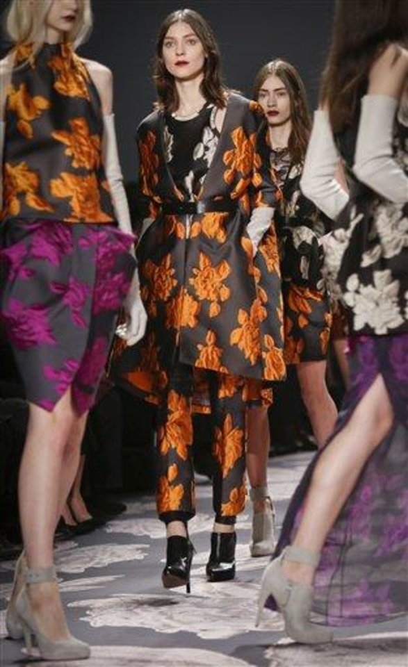 Photo -  Fashion from the Vera Wang Fall 2013 collection is modeled on Tuesday, Feb. 12, 2013 in New York.  (AP Photo/Bebeto Matthews)