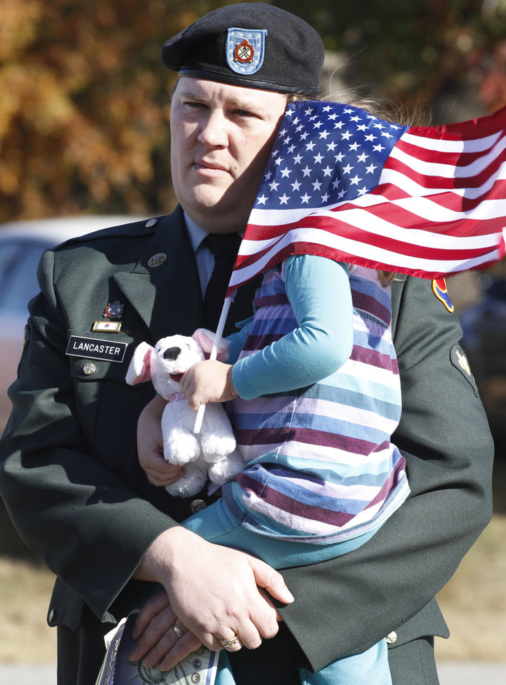 Army veteran Jarrod Lancaster holds his 3yr old daughter Emylee during the 45th Infantry Museum's Veteran's Day ceremony in Oklahoma City , Friday November, 11,  2011. Photo by Steve Gooch