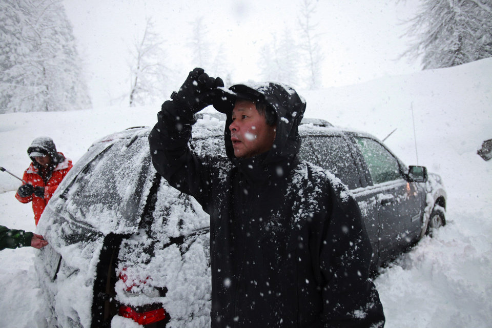 Photo - This photo taken Saturday, April 13, 2013 shows Won Shin, 56, of Mukilteo, Wash. who was among the four who made it off the mountain first. Shin, was among the group of 12 snowshoers who were on Red Mountain at the time of the avalanche. (AP Photo/The Seattle Times, Ken Lambert)